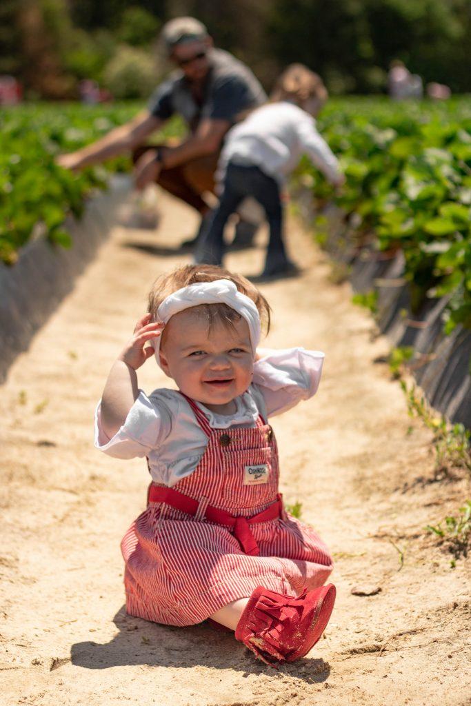 Nicki Odom baby girl in strawberry field