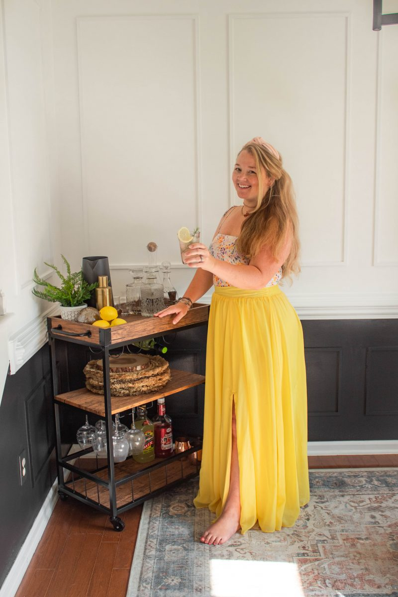 Nicki Odom in Yellow Maxi Skirt Holding Front Porch Lemonade with recipe on the blog
