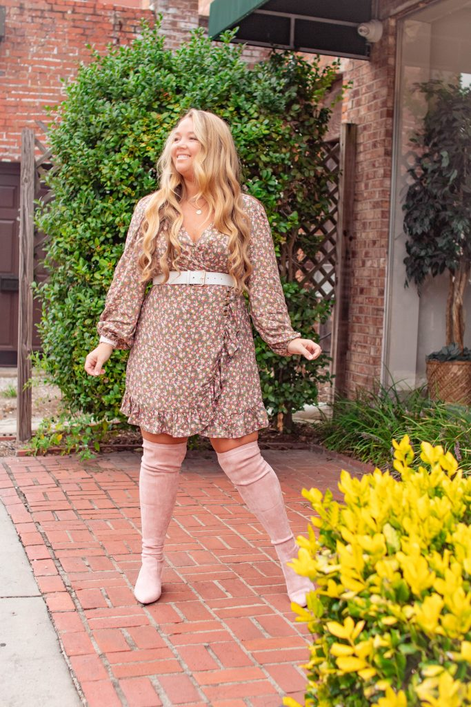 Nicki Odom in fall outfit, floral dress with pink over the knee boots